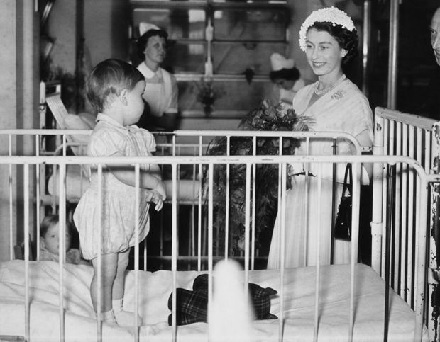 Queen Elizabeth II visits a ward during a tour of Great Ormond Street Hospital for sick children, 23rd July 1952