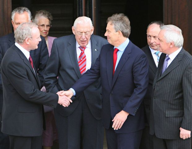 Martin McGuinness and Tony Blair look on at Stormont Parliament Buildings in Belfast in 2007