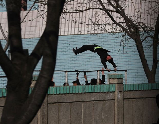 A North Korean student swings on a bar in a school in Pyongyang, North Korea