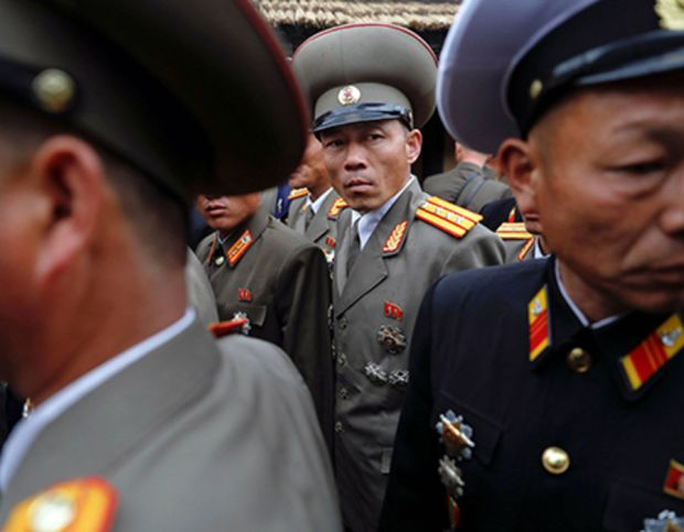 Military officers visit the birthplace of North Korean founder Kim Il Sung, a day before the 105th anniversary of his birth, in Mangyongdae, just outside Pyongyang