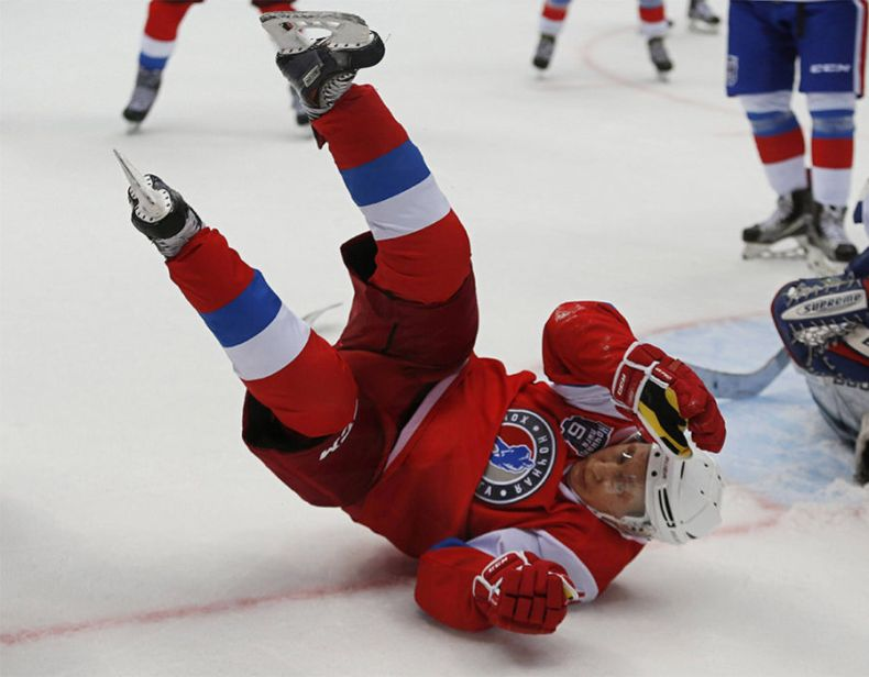 Russian President Vladimir Putin falls down during the 'Night League' teams ice hockey Gala match