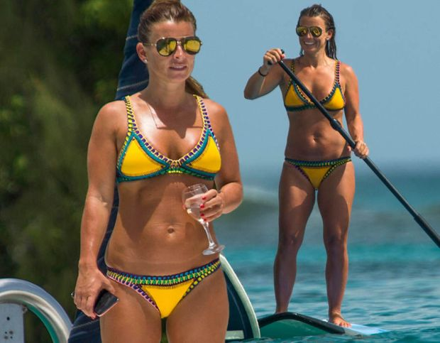 Coleen Rooney flaunts major cleavage in yellow bikini