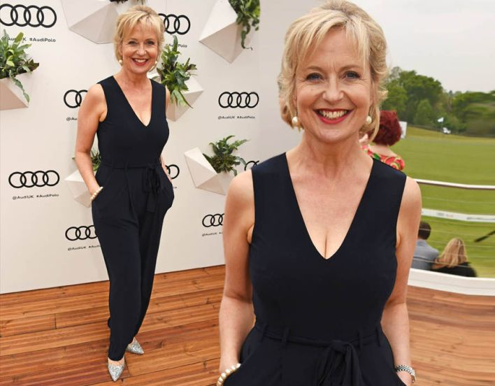 Carol Kirkwood displays serious cleavage as she sizzles in plunging jumpsuit at the Polo