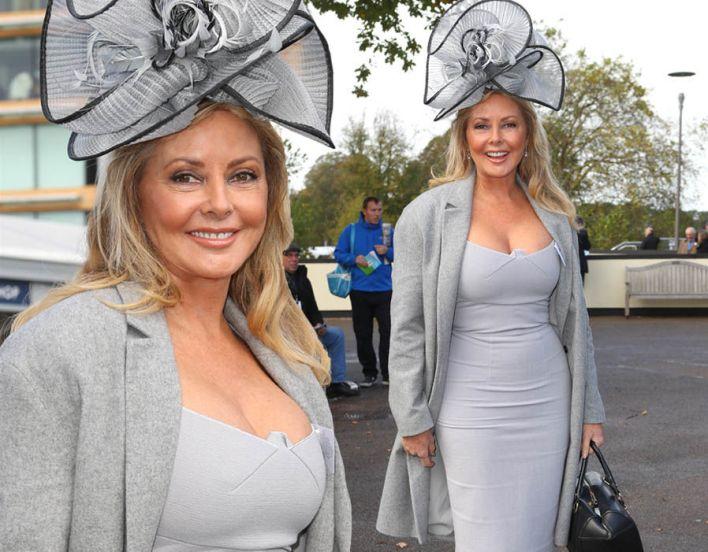 Carol Vorderman flaunts her curves in skintight dress at Ascot