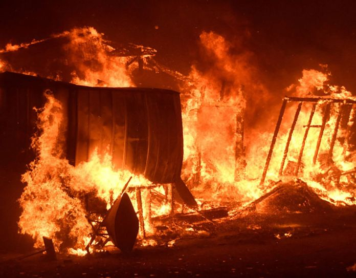 Structures burn in an early-morning Creek Fire that broke out in the Kagel Canyon area in the San Fernando Valley north of Los Angeles