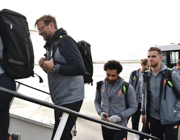 Manager Jurgen Klopp is followed onto the plane by Mohamed Salah and Jordan Henderson