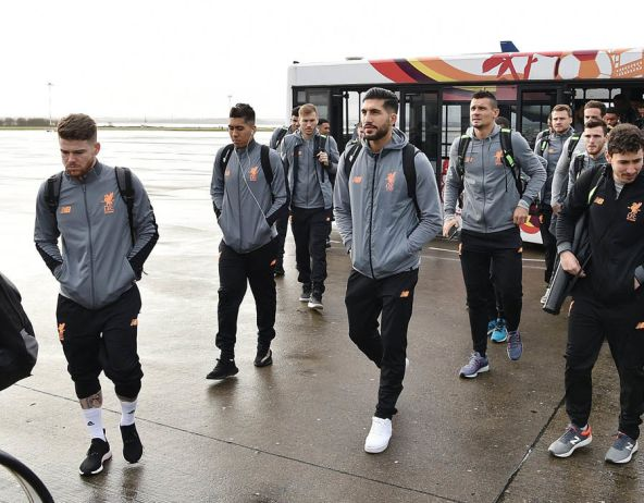 Liverpool board a plane at Liverpool John Lennon Airport ahead of their Champions League clash with FC Porto