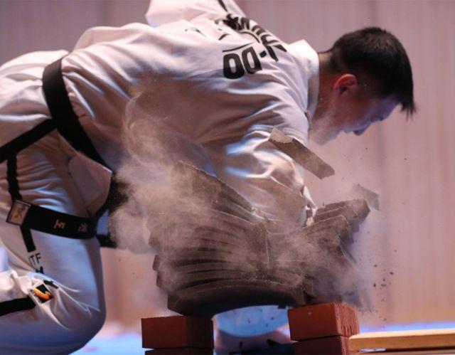 A North Korean taekwondo athlete performs at an event in Sokcho, Gangwon Province, South Korea