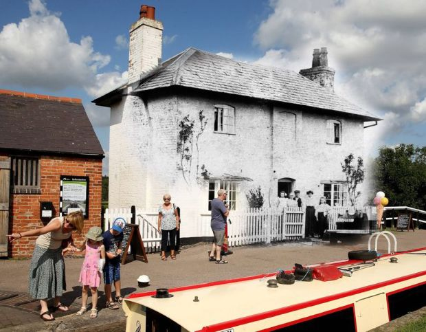 In this overlayered composite with an archive image supplied by the Canal & River Trust, a comparison is made of Top Lock Cottage at Foxton Locks in Leicestershire as it celebrates its 200th birthday, on August 7, 2014 in Market Harborough, England.