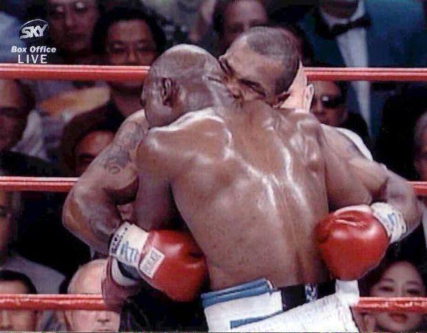 Mike Tyson bites Evander Holyfield