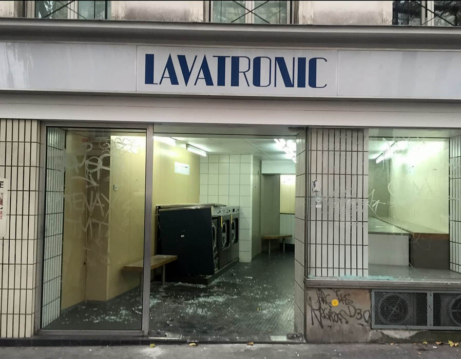 Bullet holes and smashed windows in restaurants and buildings on Rue De La Folie-Mèricourt, Paris