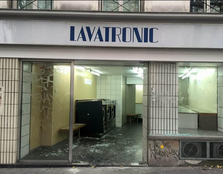 Bullet holes and smashed windows in restaurants and buildings on Rue De La Folie-Mèricourt, Paris