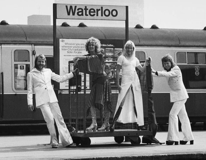 Swedish pop group ABBA pose outside Waterloo train station in London