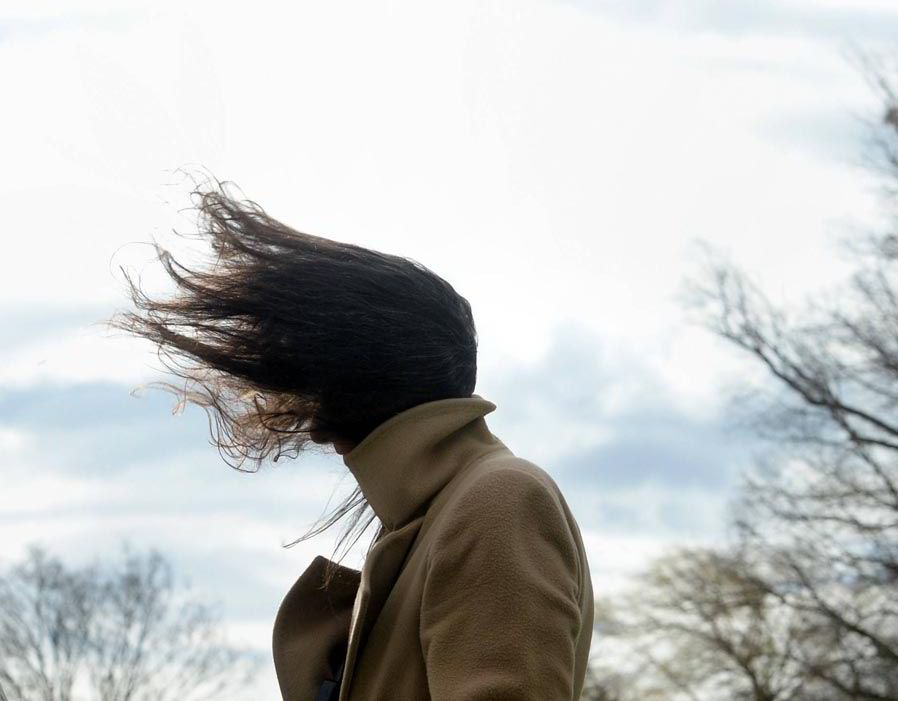 A Woman Has Her Hair Fluttering Extreme Weather Record