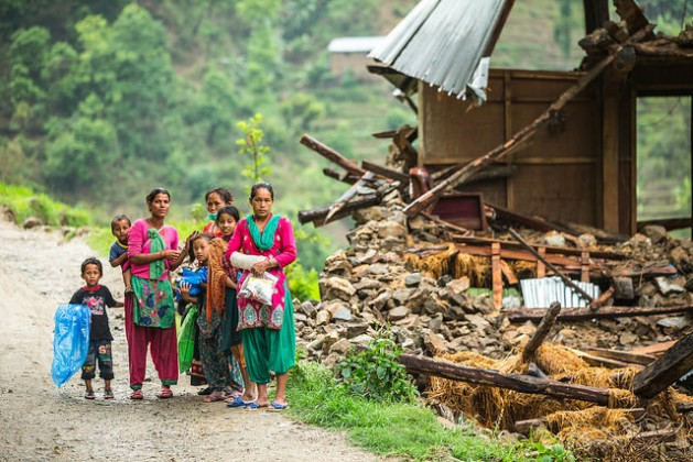 A family stands beside a damaged house near Naglebhare, Nepal. The housing sector bore the brunt of the April earthquake, accounting for three-fifths of all damages. Credit: Asian Development Bank/CC-BY-2.0