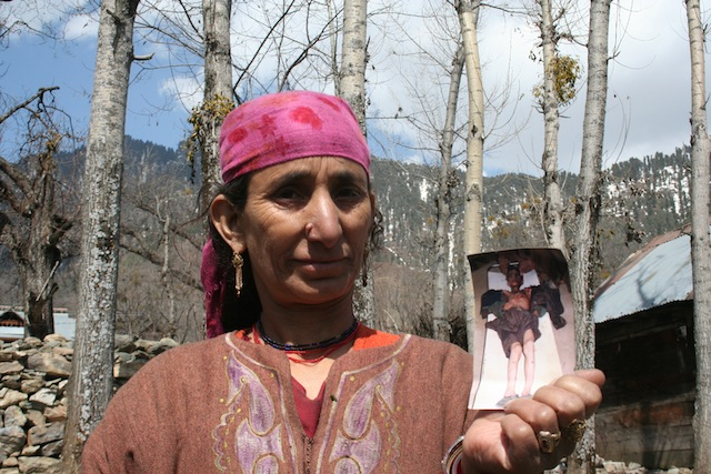 A woman holds up a picture of her son, injured in the conflict. Here in Kashmir, women often bear the brunt of fighting and some have been subjected to rape at the hands of the armed forces. Credit: Athar Parvaiz/IPS