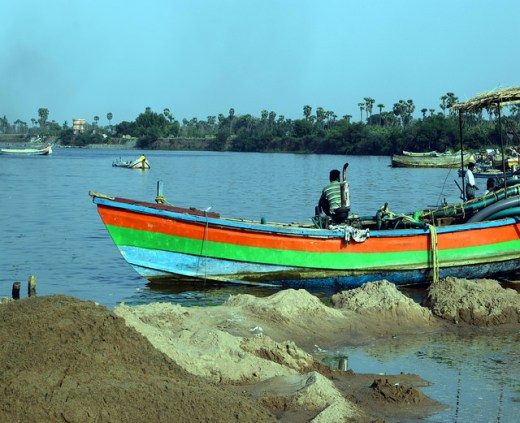 These illegal sand mining boats in India's populous Andhra Pradesh state are becoming a rare sight after women's self-groups took over mining operations last year. Credit: Stella Paul