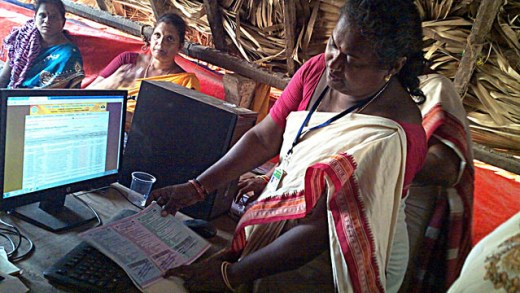 Rural women who have taken over sand mining operations in the southeastern Indian state of Andhra Pradesh are learning to use computers for the first time. Credit: Stella Paul/IPS