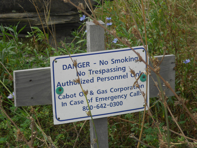 A warning about the danger of methane emissions in one of the shale gas Wells in Dimock, Pennsylvania. Credit: Emilio Godoy/IPS