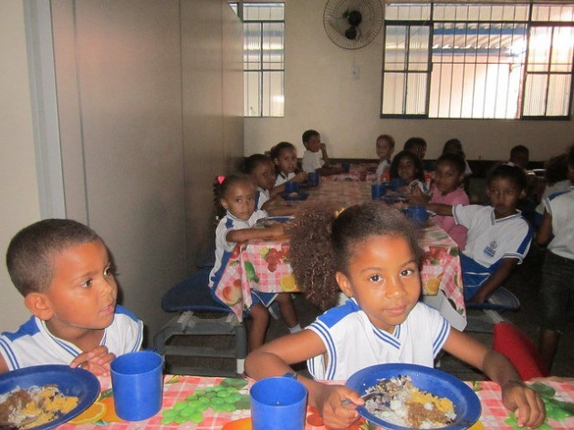 Children between the ages of five and seven eating lunch in the João Baptista Cáffaro School cafetería in the impoverished Engenho Velho neighbourhood in the city of Itaboraí, 45 km from Rio de Janeiro. Credit: Mario Osava/IPS