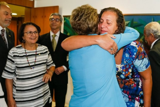 Brazilian President Dilma Rousseff, her back to the camera, receives a hug on Monday Apr. 18 by one of the minority of lower house legislators who voted against her impeachment the day before. Credit: Roberto Stuckert/PR