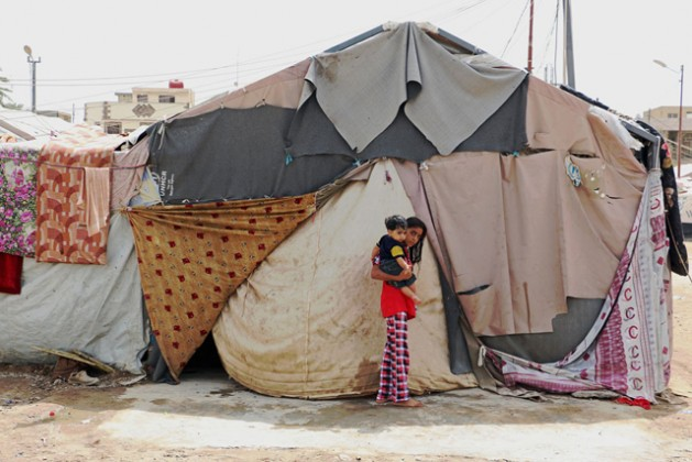 A family living in this tent in Baghdad, Iraq, explains that the camp and the tents were not ready for winter. Credit: WFP/Mohammed Al Bahbahani