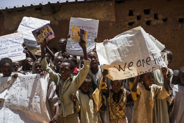 Sudanese refugee children protest against food ration cuts at Touloum refugee camp in Chad | Credit: IRIN