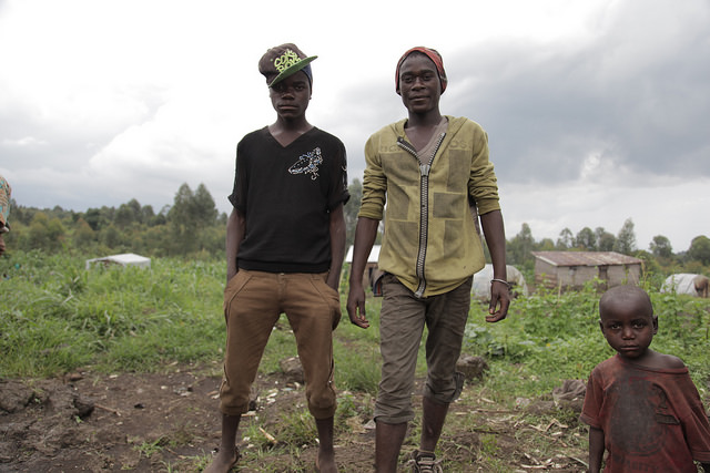 Jean Claude (18, right), poses with his friend Denis Sinzira. Most of the youth in Biganiro, DRC go to school until they are 9 or 10 years old. Credit: Zahra Moloo/IPS