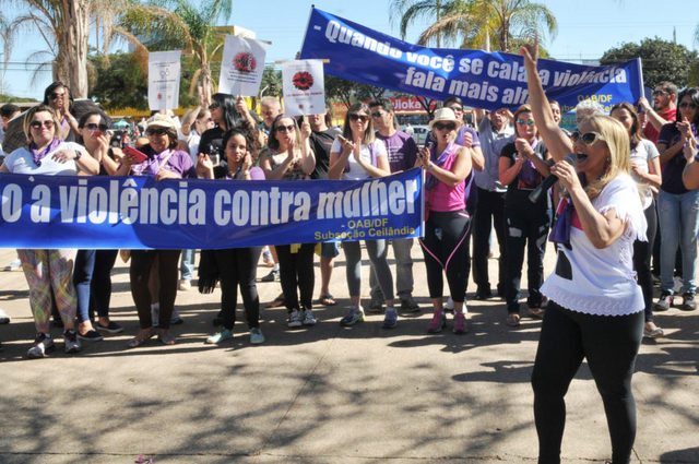 "Demonstrators call for full enforcement of the Maria da Penha Law against domestic violence in Brazil, 10 years after it was passed. One of the signs reads: ""When you remain silent, violence speaks louder."" Credit: Tony Winston/ Agência Brasília"