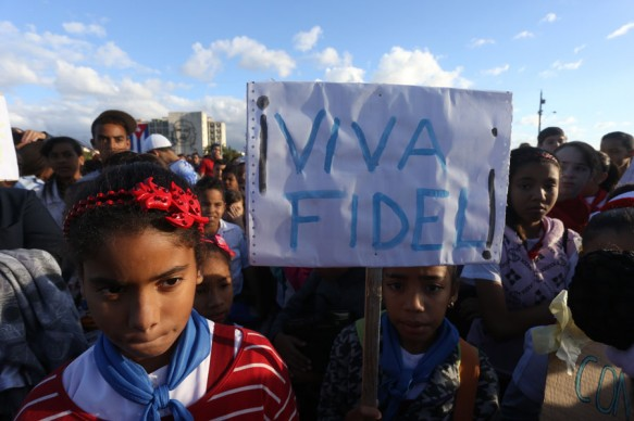 """Viva Fidel"" reads a sign carried by a girl during a rally in the Plaza de la Revolución in Havana. After he withdrew from public life, the image of Fidel Castro was still heavily present among every generation in Cuba, including the youngest. Credit: Jorge Luis Baños/IPS"