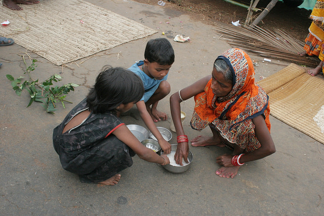 A week after losing their home to flood waters, this homeless family in Odisha still lives on an asphalt road. The father has left to work in a brick kiln in the neighbouring state of Andhra Pradesh. Credit: Manipadma Jena/IPS