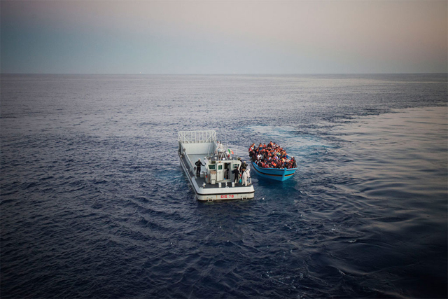 Risking their lives to reach Europe from North Africa, a boatload of people, some of them likely in need of international protection, are rescued in the Mediterranean Sea by the Italian Navy. Photo: UNHCR/A. D'Amato