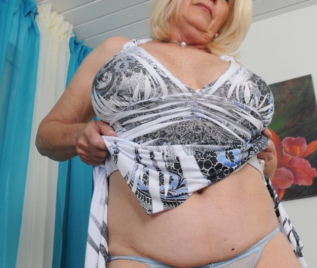 Pierced Hot Granny Flashing Her Pierced Nipples And Upskirt