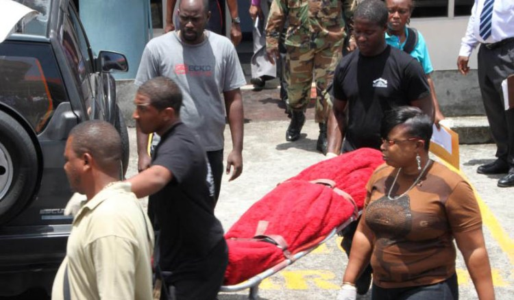 Police Officers Look On As Funeral Home Employees Remove Hamilton'S Body From The Court Building On Tuesday. (Internet Photo)