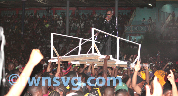 Fya Empress Is Carried Aloft On Top A Platform To The Stage.
