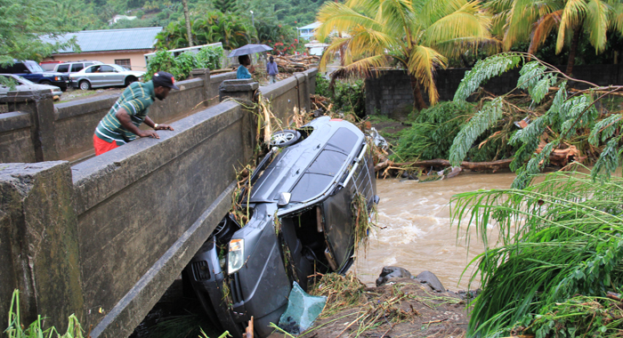 In Addition To The Lost Of Life, There Was Extensive Damage To Property, Including Vehicles Which Were Washed Away. (Iwn Photo)