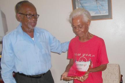 Velma Jackson, Right, Receives Her Plaque From Errol Allen.