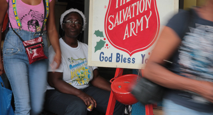 A Woman Eats While Volunteering At A Salvation Army Donation Point On Christmas Eve In Kingstown. (Iwn Photo)