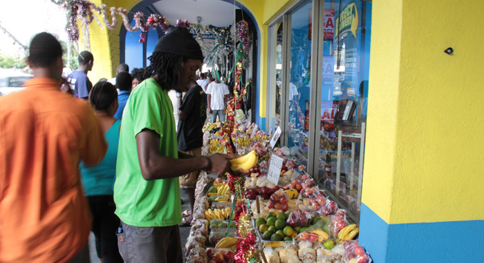 A Man Sells Fruits From A Stand Decorated In Keeping With The Christmas Season. (Iwn Photo)