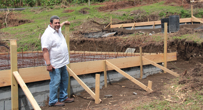 Prime Minister Gonsalves Poses In Fitz Hughes Where Houses Are Being Built For Disaster Victims And Robertson. (Iwn Photo)