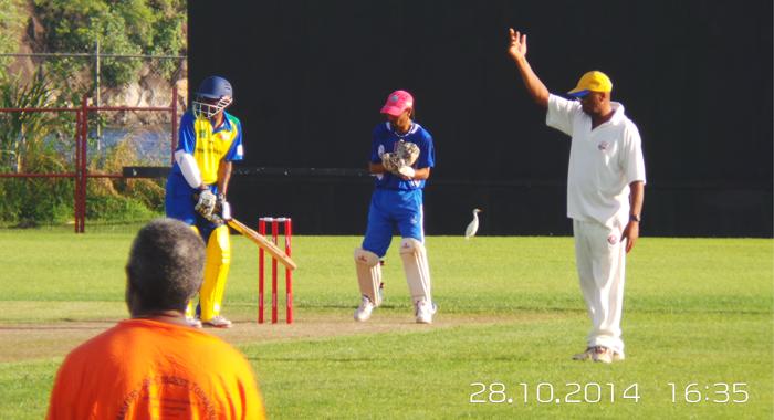 Cheldon &Quot;Keegan&Quot; Mcmillan Waits At The Crease While Av Captain, The Fastidious Basil Weekes, Makes A Fielding Change. Wicketkeeper Is Joseph Carrington. (Photo: E. Glenford Prescott)