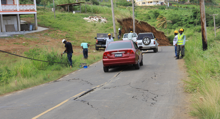 Vehicles Drive Along The Argyle Main Road On Saturday, Where Cracks Began To Appear On Friday. (Iwn Photo)