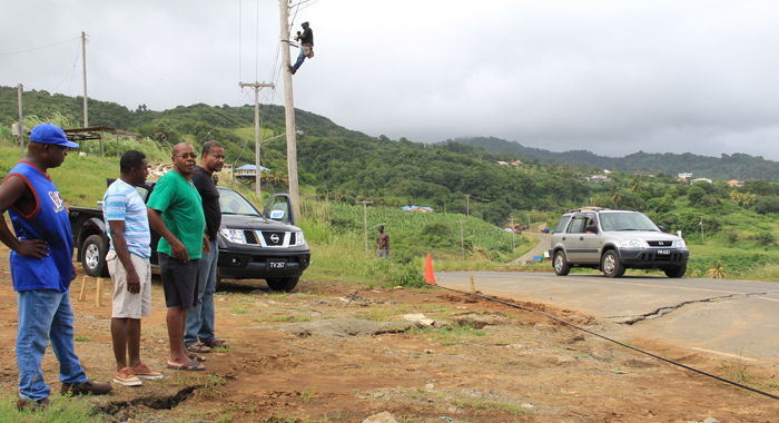General Manager Of Cwsa Garth Saunders, Right, And Other Cwsa Staff At The Site  On Saturday. (Iwn Photo)