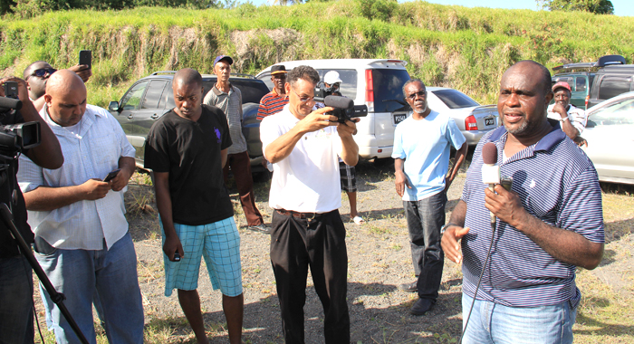 Businessman Leon &Quot;Bigger Bigs&Quot; Samuel Speaks With Reporters On Saturday. Environmentalist Dr. Reynold Murray Is Second From Right. (Iwn Photo)