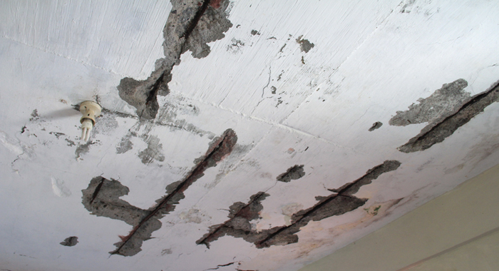 Parts Of The Concrete Roof Of The House Have Been Cracking Off. (Iwn Photo)