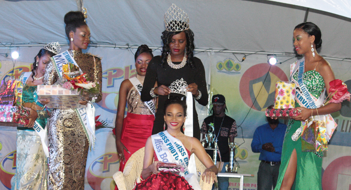 Miss Easterval 2015 Miss Barbados Ieashia Browne  Is Crowned By The 2014 Winner Of The Crown, Miss Union Island Phillis Denbar. First Runner-Up,  Miss St. Vincent Nikianna Williams Is At Left, And   Second Runner-Up, Miss Grenada Deronna Farray At Right. (Iwn Photo)