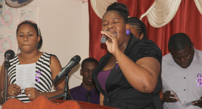 Nick'S Sister, Nakeisha Chance-John Leads The Singing During His Funeral Service On Sunday. (Photo: Nakeisha Chance-John)
