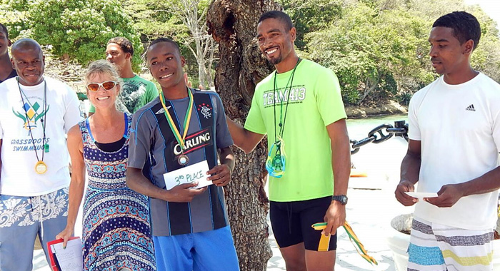 From Left: Coach Kara Randall, Swimmer Tyrell Raguette Receiving Third Prize And Coach Tauran Ollivierre.
