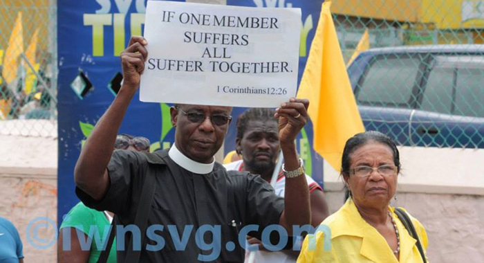 Rev. Ulric Jones And Other Persons Take Part In A Protest March Organised By The Opposition New Democratic Party In Kingstown In July 2013. (Iwn Photo)