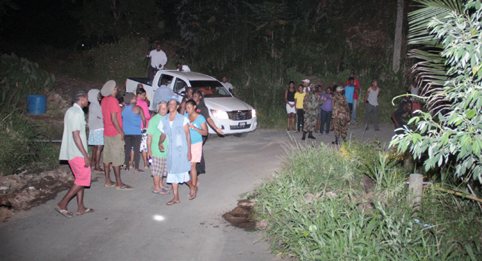 Civilians Gather At The Scene After Police Conducted Initial Investigations Tuesday Night. (Iwn Photo)